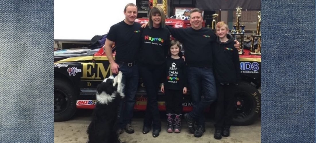 Johnson family with race-truck